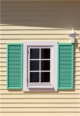 Using Shutters To Improve Your Home's Curb Appeal